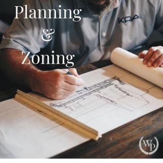 Image of person working on a building drawing, with the words Planning and Zoning