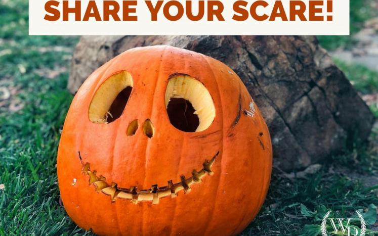 """Carved pumpkin with title """"Share your Scare"""""""